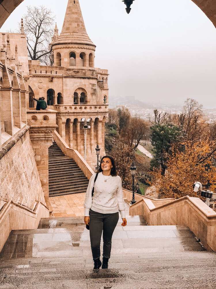 Kat wearing a white pom pom sweater and olive jeans in Budapest - What to wear in Budapest