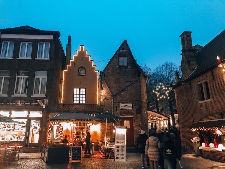 Old buildings and street cafes in Bruges-Bruges Day Trip