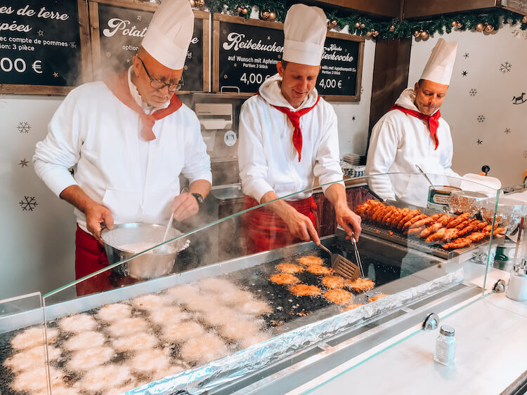 Potato pancakes being made at the Cologne Cathedral Christmas market
