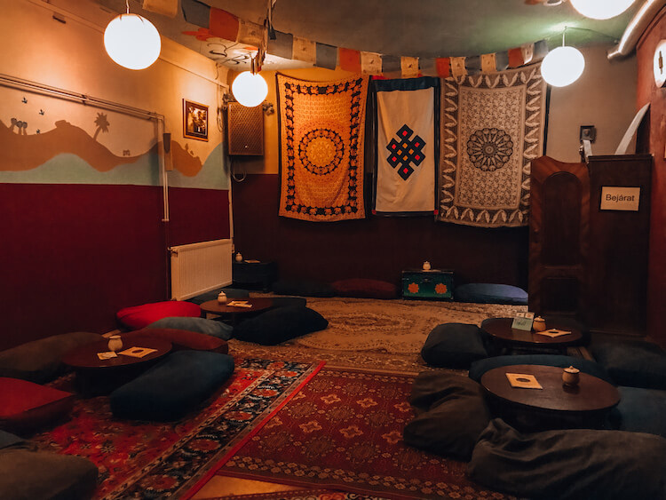 Sirius Teahouse main room with poofs as chairs in Budapest, Hungary
