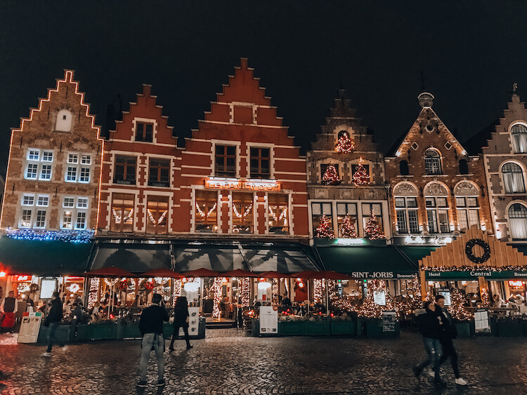 Storefronts lit up at night in Bruges-What to see in Bruges