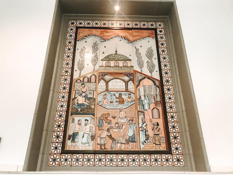 Artwork showing the ancient Turkish bath with men in the octogonal pool at Rudas Baths