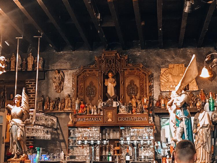 Bar area inside of Elfde Gebod with alter peices