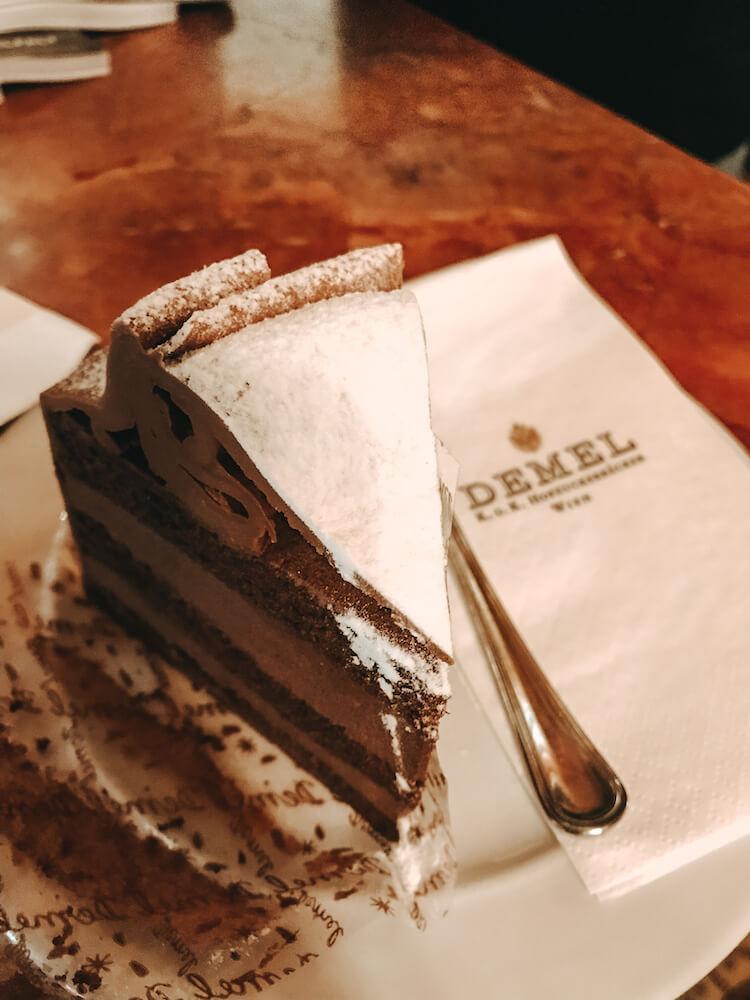 Cafe Demel chocolate hazelnut cake with napkin in Vienna, Austria- Where to Eat in Vienna
