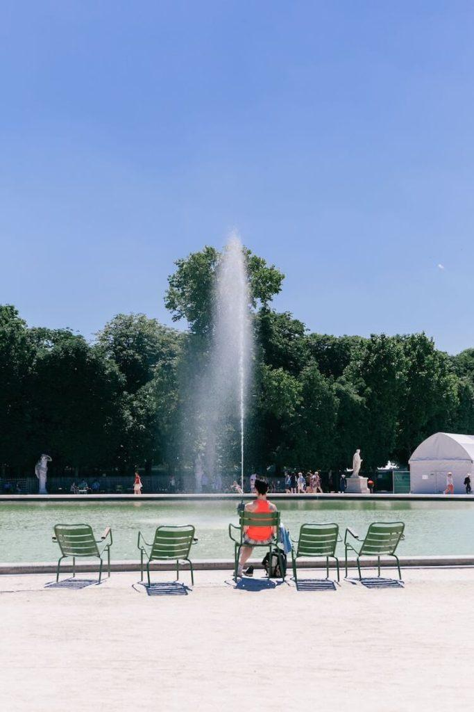 Chairs in front of the fountain at Tuileries Garden - One Day in Paris