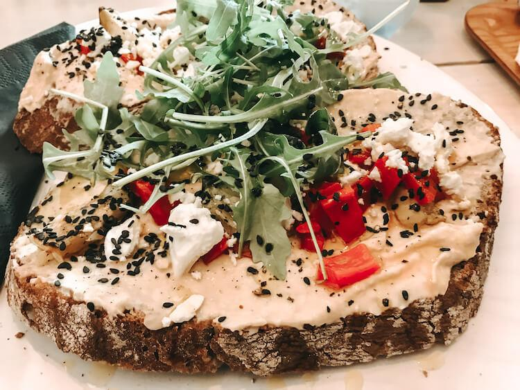 Hummus Toast with arugula, red peppers, and feta and Crumbles and Beans in Antwerp