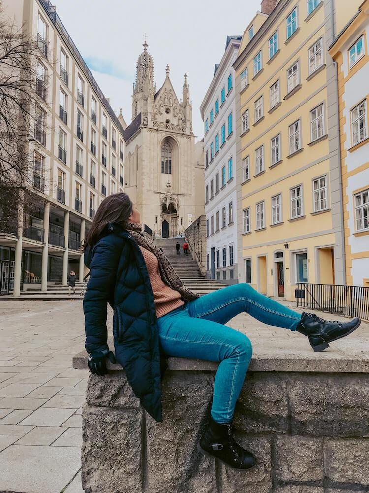 Kat reclining on a wall in Vienna