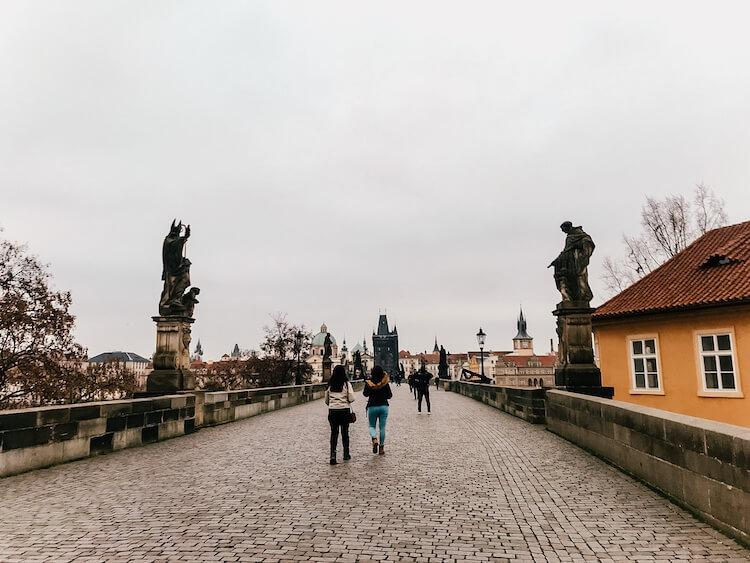 Charles Bridge in the morning with statues along it