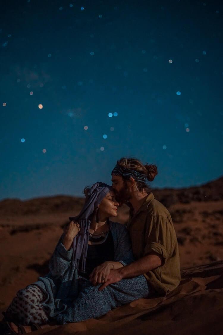 Couple admiring the starts in the Sahara Deset- Couple's Travel Bucket List