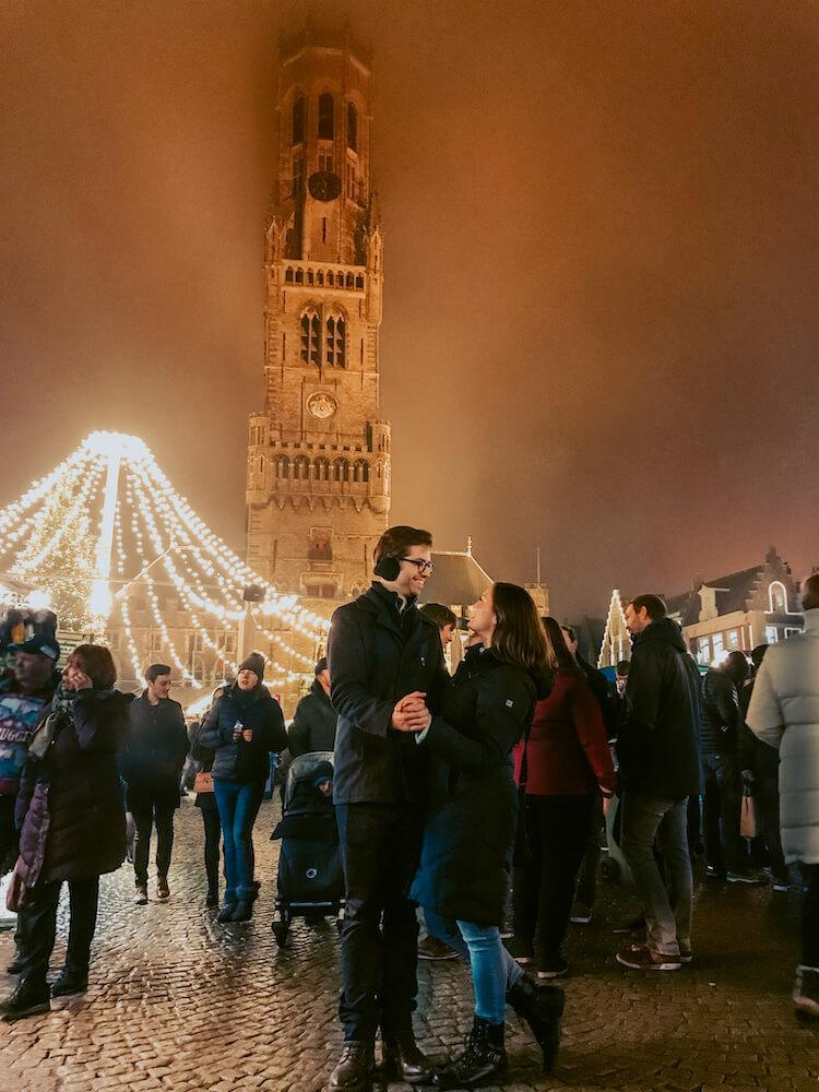 Kat and Chris in Bruges at the Christmas Market- Best Bucket List Ideas for Couples Who Travel
