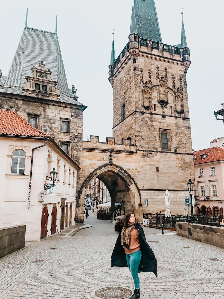 Kat in front of the Lesser Town Tower in Prague