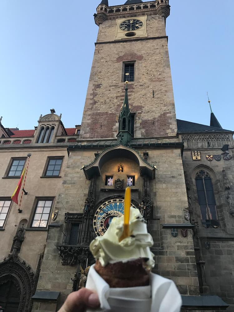 chimney cake in front of Prague Astronomical Clock
