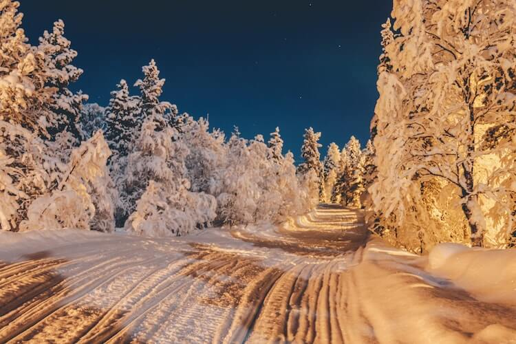 Lapland, Finland at night along a snowmobile trail- Romantic honeymoon destinations in Europe