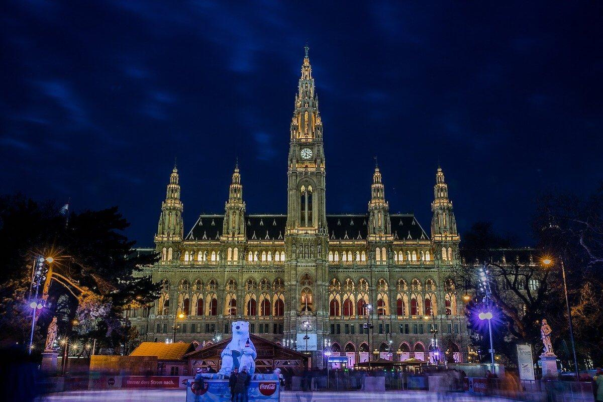 Icerink at the Vienna Townhall lit up at night in December