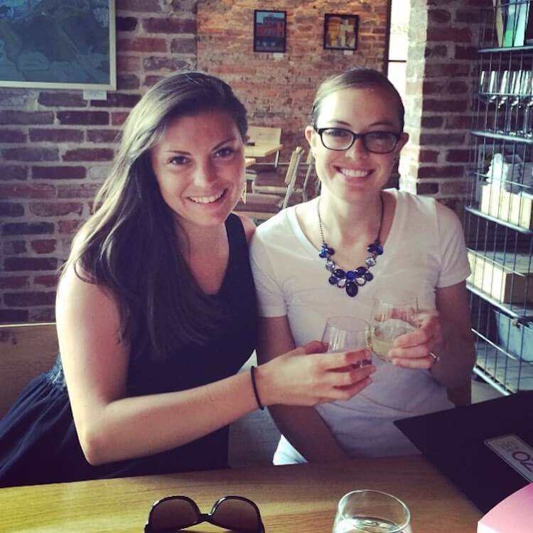 Kat and her sister, Amanda, drinking wine at Eno DC