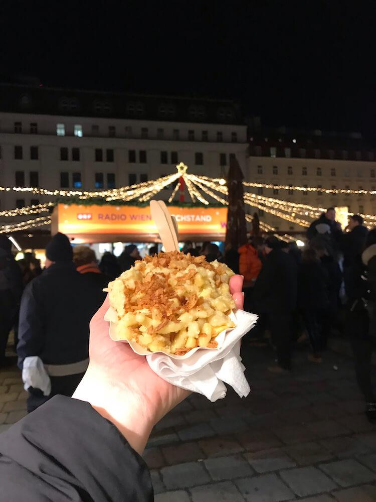 Spaetzle with crispy onions at the Am Hof Christmas Market- Vienna in December