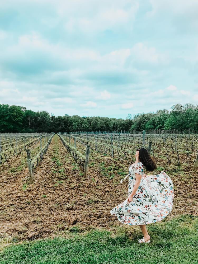 M Cellars vineyard with Kat spinning. Wineries in Geneva Ohio