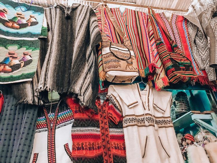 Peru sweaters at a market in Peru - Best Peruvian Souvenirs