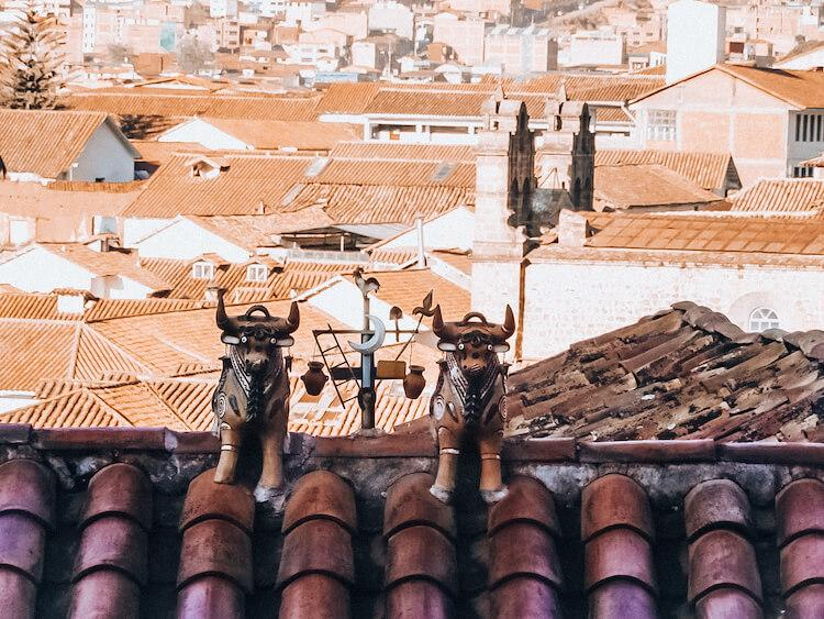 Pucara Bulls sitting on top of a roof in Cusco - Cusco souvenirs