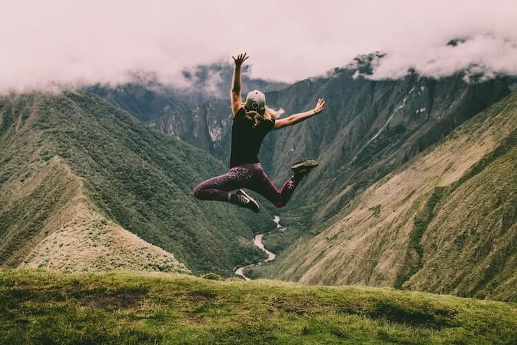 woman jumping after her day hike