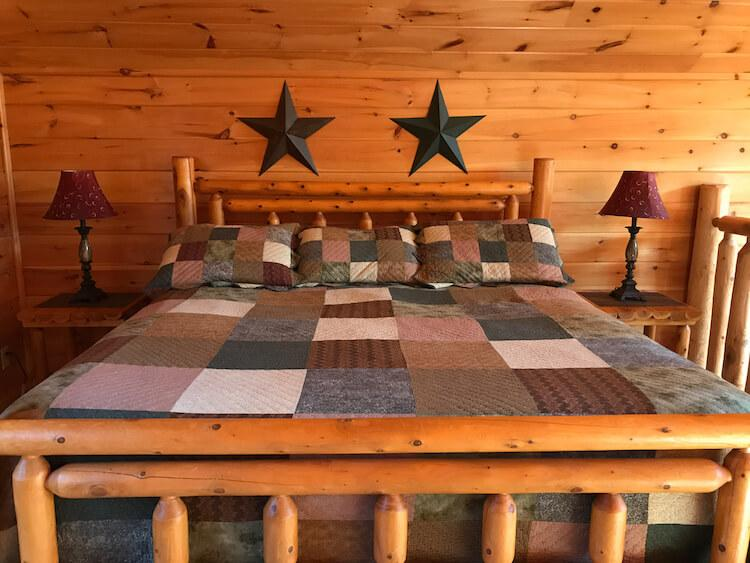 Quilted bed in our Airbnb Cabin in the Smoky Mountains