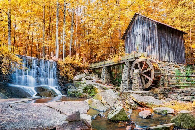Fall-in-Georgia-Marietta-historic-mill-and-waterfall - Best Fall Vacations in the US