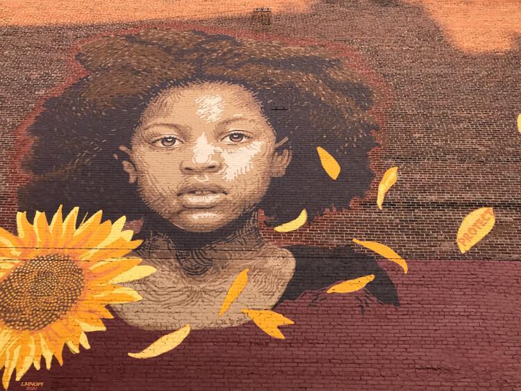 Black child with sunflower mural in Rutland