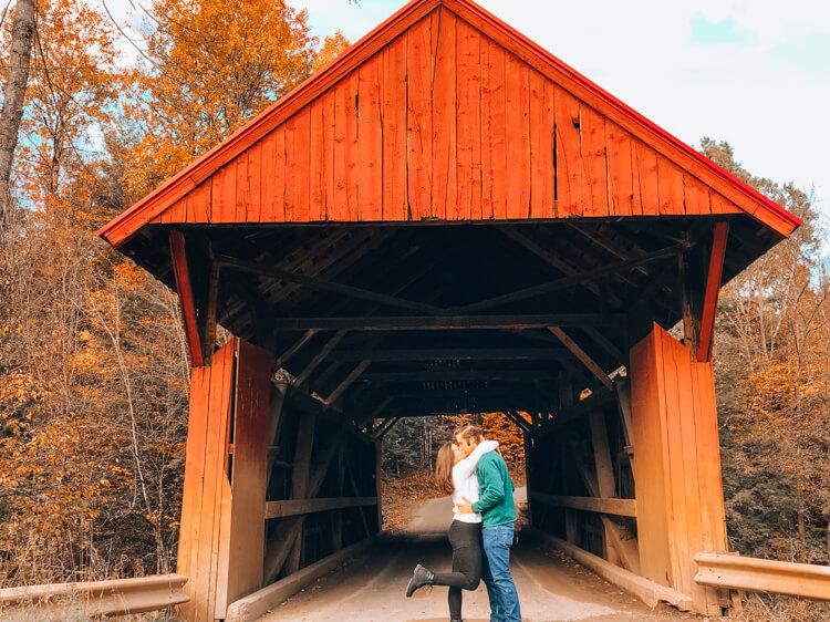 Kat and Chris at Red Covered Bridge   Road Trip Tips for Vermont