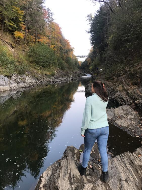 Kat-looking-out-over-Quechee-Gorge-Vermont-Fall-Road-Trip-Itinerary