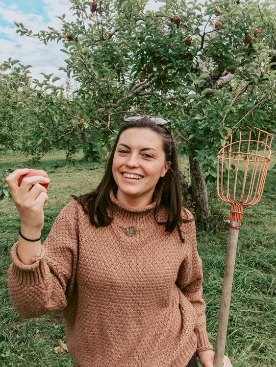 Kat picking apples at Shelburne Orchards - Road Trip Vermont