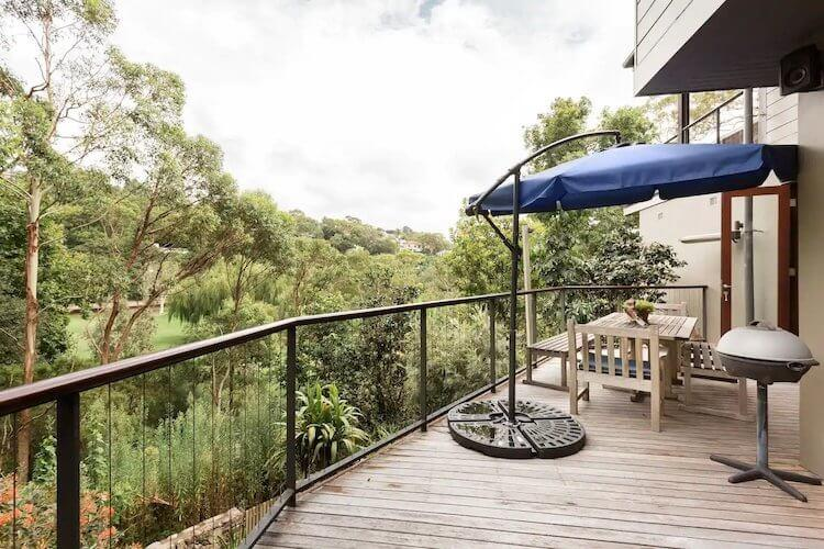 Hidden Hideaway with lots of greenery on the back deck of a Sydney Airbnb