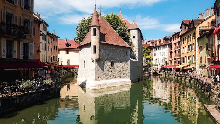 Palais de L'ile during the day in the middle of the canal in Annecy