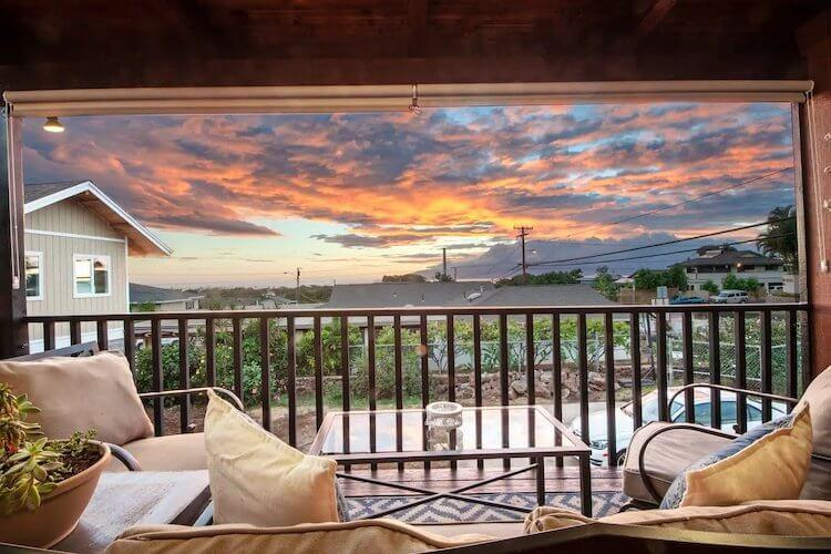 Views of the sunset over the town and mountains in Maui, Hawaii from a luxury Airbnb apartment