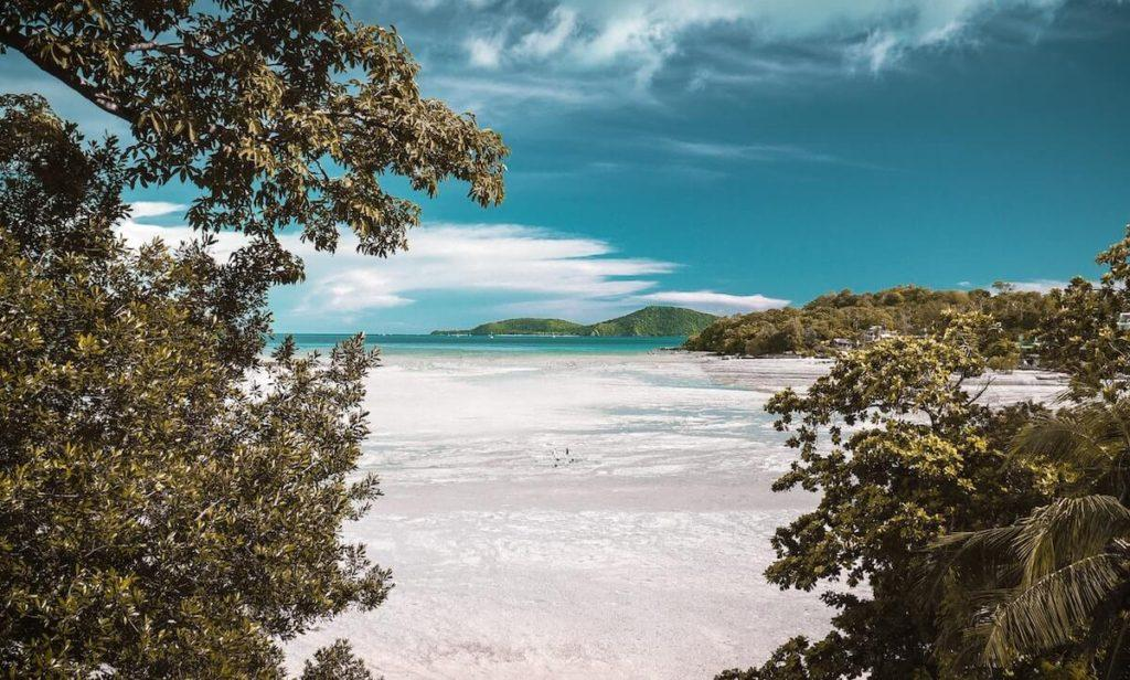 7 Tips for Your Honeymoon - Beach destination with mountains in the background and the seashore in the front