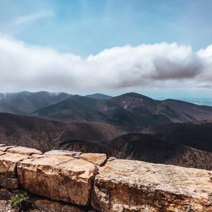 Best Things to do in Shenandoah National Park - Overlook from Skyline Drive showing rolling mountains with clouds overhead
