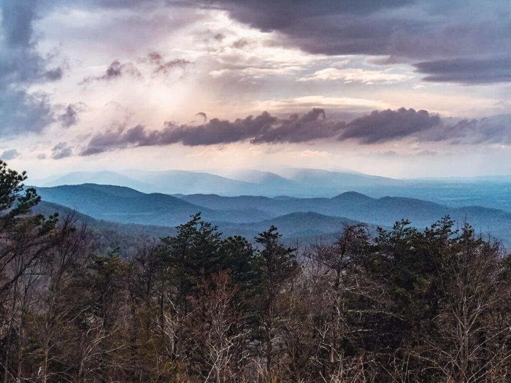 Best Things to do in Shenandoah National Park - Shenandoah National Park around the evening with the sun poking through the clouds over rolling mountains