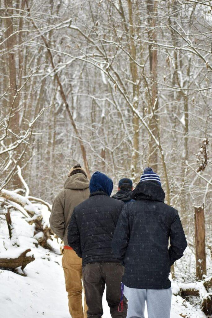 Four men hiking on a snowy trail in Shenandoah National Park