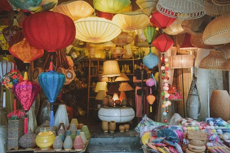 Lamps and baskets surrounding the entryway of a shop in Hanoi