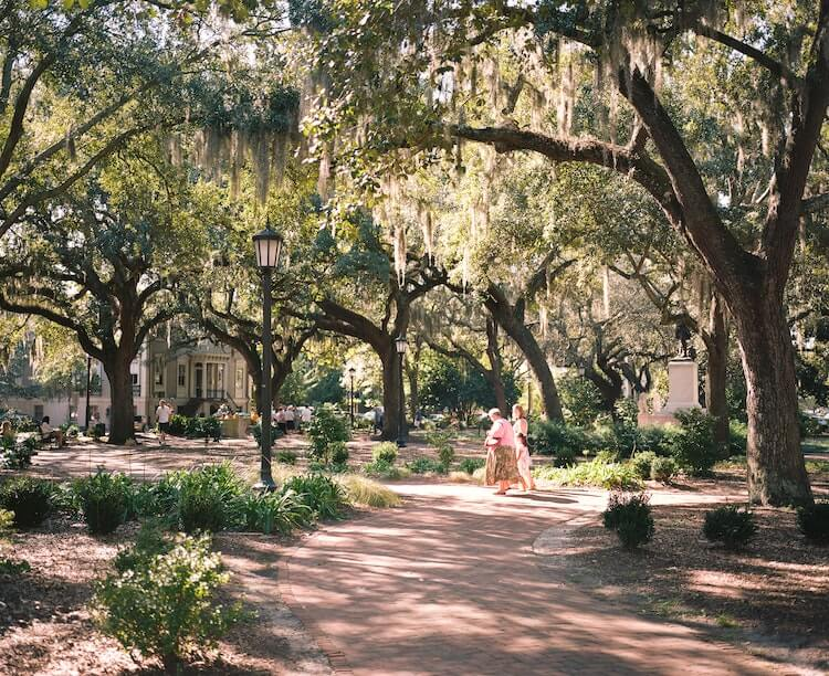 Women walking in a park in the middle of Savannah - Best Honeymoon Destinations in the USA