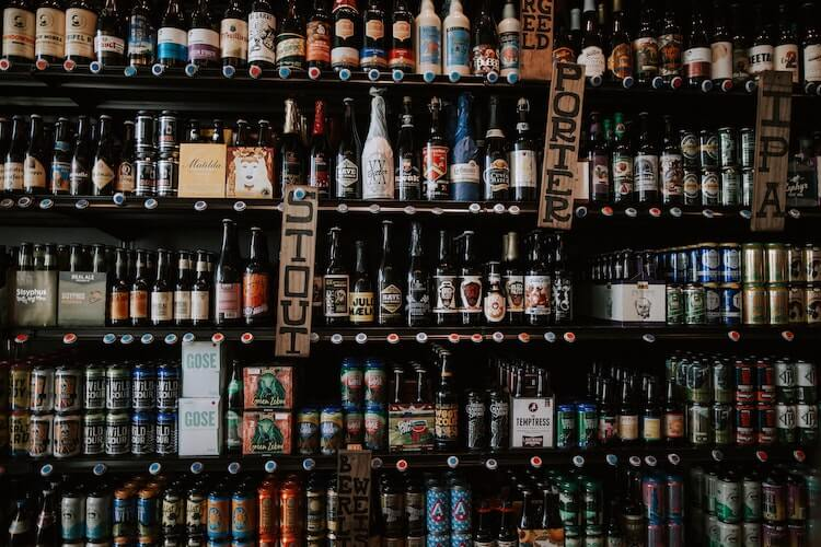 beer bottles displayed on a wall