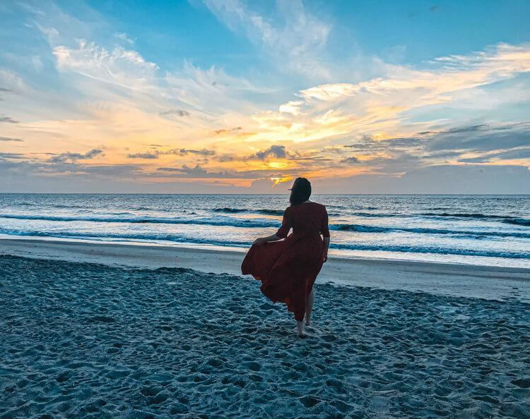 Kat watching the sunrise on Tybee Island