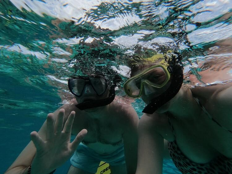 Snorkeling in Belize - Kat and Chris with their snorkels on looking at the camera