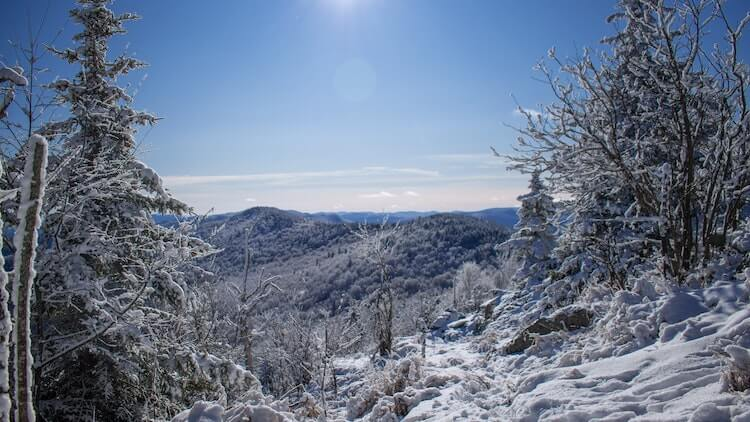 Snow covered mountains in Vermont - Romantic Things to do in Vermont