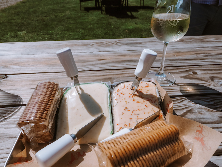 Wine and cheese tray on a picnic table