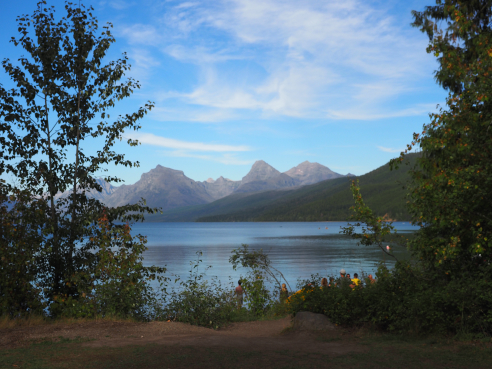First views of the trees and moutains at Lake McDonald | Glacier National Park Itinerary