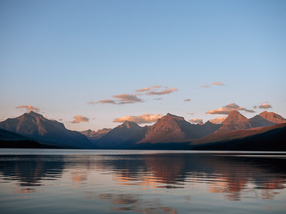 Lake McDonald at sunset with the mountains in the background | Itinerary For Glacier National Park