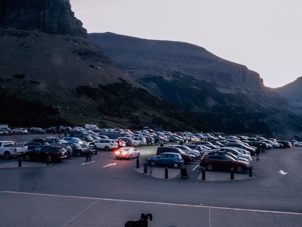 Logan Pass Parking Lot at 7 am that is full of cars