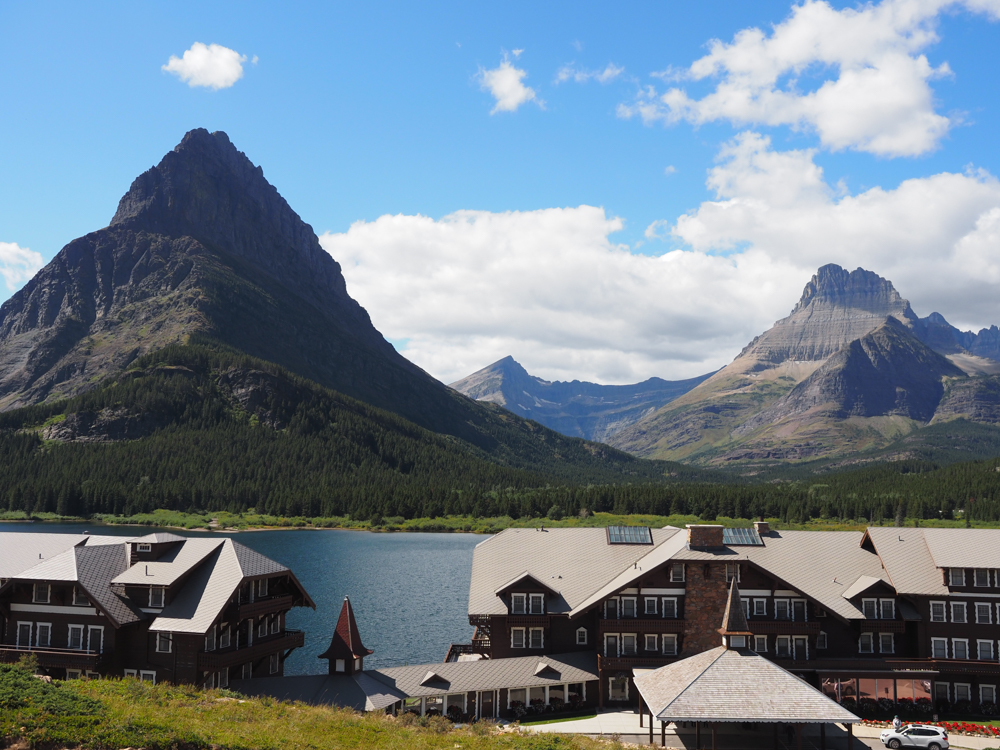 Many Glacier Hotel with Swiftcurrent Lake and the mountains in the background