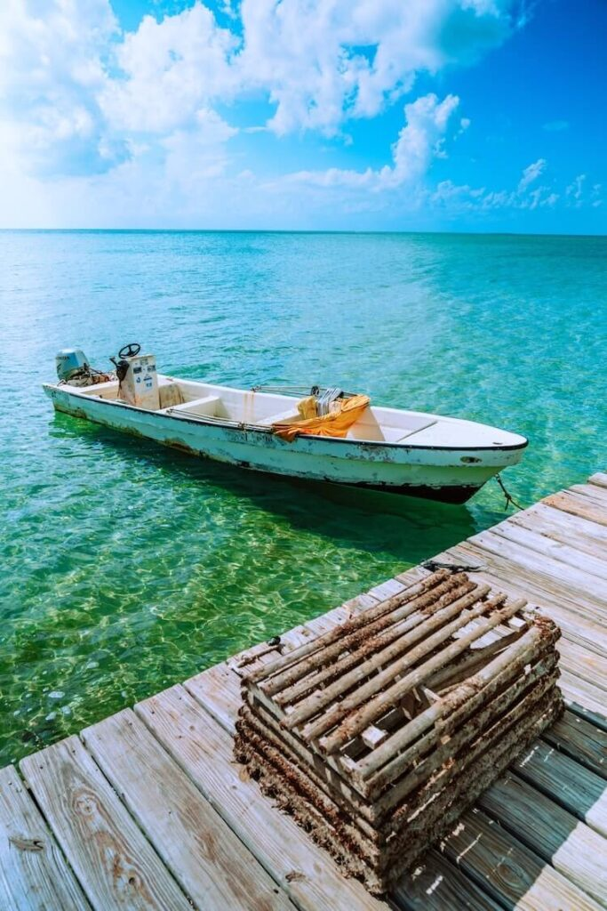 Boat on the water next to a dock in San Pedro Belize