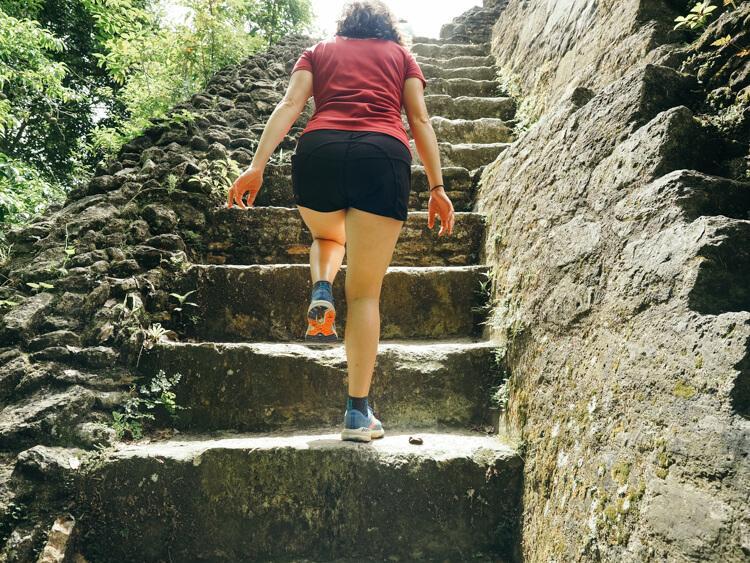 Kat climbing some stairs at Xunantunich